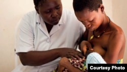 Nurse Koletha teaches Mwajuma how to breastfeed her one-day-old baby boy at the Lindi Regional Hospital, Tanzania. (Credit: Caroline Trutmann / Save the Children )