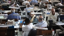Diamond dealers work on the trading floor of Israel's diamond exchange in Ramat Gan near Tel Aviv, October 30, 2012.