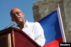 FILE - Haiti's President Michel Martelly addresses the audience during a memorial held for the victims of the 2010 earthquake in Titanyen, on the outskirts of Port-au-Prince, Jan. 12, 2015.