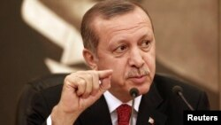 Turkey's Prime Minister Tayyip Erdogan talks to the media in Istanbul, Feb. 3, 2014.
