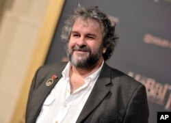 """FILE - Writer/director/producer Peter Jackson arrives at the Los Angeles premiere of """"The Hobbit: The Battle Of The Five Armies"""" in Los Angeles, Dec. 9, 2014."""