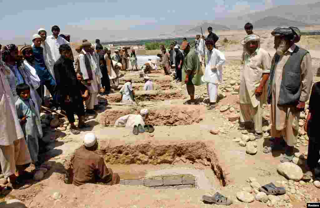 Graves are prepared for the burial of victims of a roadside bomb in Laghman province June 3, 2013.