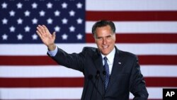 Republican Presidential candidate, former Massachusetts Gov. Mitt Romney declares victory in the Wisconsin presidential primary, April 3, 2012, at the Grain Exchange in Milwaukee.