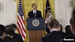 Presiden AS Barack Obama memberikan konferensi pers di Gedung Putih hari Senin (14/1).