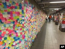 Anti-Trump Stickies posted Thursday at New York City rail station.