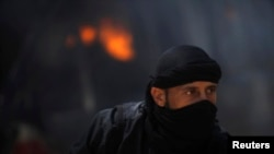 FILE - A fighter from the Islamist Syrian rebel group Nusra Front.