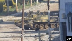 A Syrian tank is seen in Baba Amr near the city of Homs, February 12, 2012.