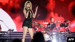 FILE - Singer-songwriter Taylor Swift performs her only full concert of 2016 during the Formula 1 United States Grand Prix at Circuit of The Americas on Oct. 22, 2016 in Austin, Texas.