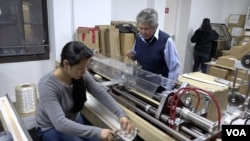 Tony Acosta and his staff produce nylon strings out of his 5,000-square-foot business in lower Manhattan, March 2016. (R. Taylor/VOA)
