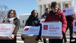 "Members of the Human Rights Campaign deliver ""People's Brief"" with more than 200,000 signatures in support of marriage equality to the Supreme Court in Washington, March 6, 2015."