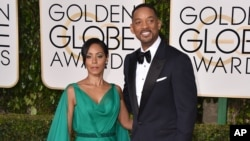 Jada Pinkett Smith and her husband, Will Smith, arrive at the 73rd annual Golden Globe Awards at the Beverly Hilton Hotel in Beverly Hills, Calif., Jan. 10, 2016. Pinkett Smith said she would boycott this year's Oscars to protest the lack of diversity amo