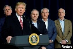 U.S. President Donald Trump speaks to reporters after a congressional Republican leadership retreat at Camp David, Md., Jan. 6, 2018. From left are House Majority Leader Kevin McCarthy, R-Calif., Trump, House Majority Whip Steve Scalise, R-La., Secretary of State Rex Tillerson and Defense Secretary Jim Mattis.