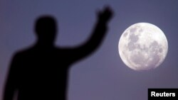 FILE - A full moon rises over the Juscelino Kubitschek Memorial in Brasilia, Brazil. (Reuters)