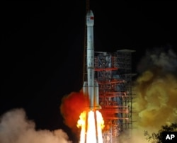 FILE - In this Dec. 8, 2018, file photo, and released by Xinhua News Agency, the Chang'e 4 lunar probe launches from the the Xichang Satellite Launch Center in southwestern China's Sichuan province. (Jiang Hongjing/Xinhua via AP, File)