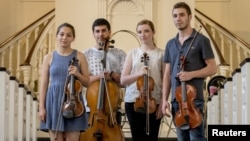 The Polyphony Quartet — from left, Revital Bendersky, Mahdi Saadi, Shir Semmel and Feras Machour — are pictured at All Souls Church in New York, May 27, 2015.