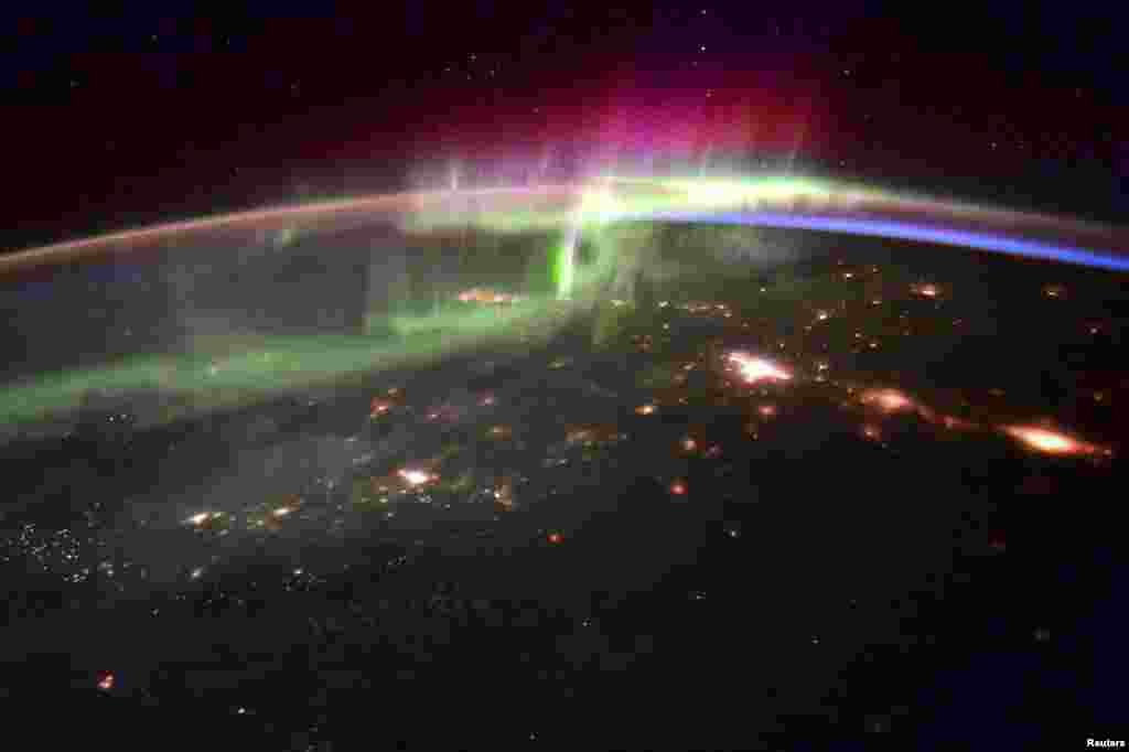 The dancing lights of the Aurora Borealis is shown over the Pacific northwest taken from the International Space Station by astronaut Scott Kelly in this handout provided by NASA, Jan. 20, 2016.