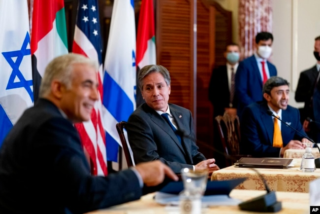 Secretary of State Antony Blinken, Israeli Foreign Minister Yair Lapid, left, and United Arab Emirates Foreign Minister Sheikh Abdullah bin Zayed al-Nahyanin, right, appear at a joint news conference at the State Department in Washington, Oct. 13, 2021.