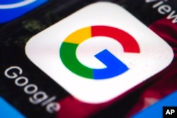 FILE - A photo shows the Google mobile phone icon, in Philadelphia, April 26, 2017.