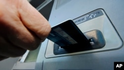 FILE - Law enforcement officials say Ercan Findikoglu hacked into credit card company computers and allowed members of a global gang to make thousands of fraudulent ATM withdrawals.