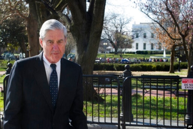 FILE - Special Counsel Robert Mueller walks past the White House, March 24, 2019.