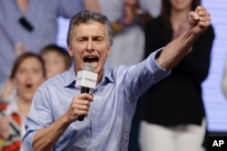 Opposition candidate Mauricio Macri celebrates after winning a runoff presidential election in Buenos Aires, Argentina, Sunday, Nov. 22, 2015.