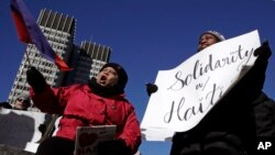 Haitian activists and immigrants protest on City Hall Plaza in Boston, Massachusetts, Jan. 26, 2018. Haitian community leaders complained last week that the Trump administration's delays in re-registering those living in the U.S. legally through the Temporary Protected Status program would lead to job losses, travel problems and other issues for Haitians.