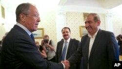 Ruski ministar inostranih poslova Sergej Lavrov sa zamenikom sirijskog premijera, Kadrijem Džamilom, u Moskvi, 22. juli, 2013.