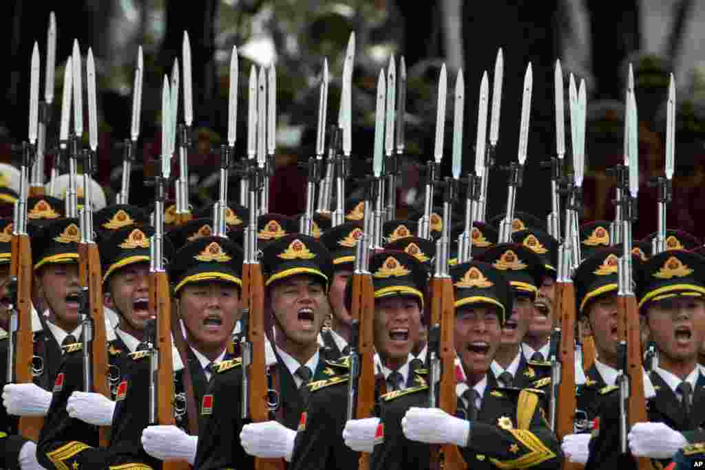 Members of a Chinese honor guard unit take part in a welcome ceremony for Belgium King Philippe in Beijing.