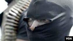 Seorang anggota kelompok militan Gerakan Emansipasi Delta Niger (MEND).
