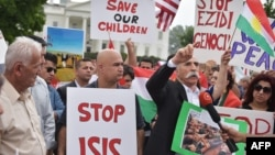 Demonstrators call for the end to Islamic State of Iraq and Syria (ISIS) terrorism during a Kurdish demonstration in front of the White House, file photo.
