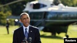 Obama Beyaz Saray'da konuşurken