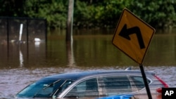 A car flooded on a local street as a result of the remnants of Hurricane Ida is seen in Somerville, N.J. Sept. 2, 2021.