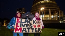 New Zealand protesters hold a vigil against the killing of Minneapolis man George Floyd in a Black Lives Matter protest outside Parliament in Wellington, June 1, 2020.