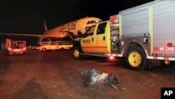 FILE - This photograph released by the state-run Saudi Press Agency shows debris on the tarmac of Abha Airport after an attack by Yemen's Houthi rebels, in Abha, Saudi Arabia, June 12, 2019.