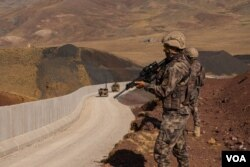 Soldiers patrol the Turkish-Iranian border trying to prevent Afghans refugees from entering Turkey, on Aug. 30, 2021. (VOA/Yan Boechat)