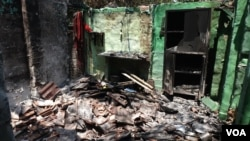 The charred room of a Muslim jute mill laborer in Telinipara, two days after it was set aflame by a Hindu mob during communal violence on May 12. During three days of violence, rioters destroyed dozens of houses and shops. (Shaikh Azizur Rahman/VOA)