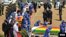 Coffins of Minister of Foreign Affairs Sibusiso Moyo, Transport Minister Joel Biggie Matiza and former head of prisons Paradzai Zimond, in Harare, Jan. 27, 2021. (Columbus Mavhunga/VOA)