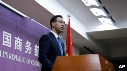 FILE - Chinese Ministry of Commerce spokesman Gao Feng speaks during a press conference at the Ministry of Commerce in Beijing, China, April 6, 2018.