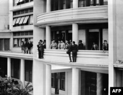 FILE - French Generals Jouhaud, Salan, Challe and Zeller are surrounded by photographers on the balcony of the general delegation in Algiers, after taking power against de Gaulle's policy in Algeria, Apr. 24, 1961. (STF/AFP)