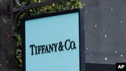 The Tiffany & Co. sign hangs in a shop window in London, Monday, Nov. 25, 2019. French luxury group LVMH has agreed to buy iconic New York jeweler Tiffany & Co. for $16.2 billion, adding a famed star to its portfolio that already boasts Louis…