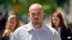 FILE - In this June 11, 2014 file photo, former Blackwater guard Nicholas Slatten leaves federal court in Washington, after the start of his first-degree murder trial.