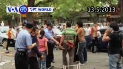 Ấu đả dữ dội trên đường phố Bắc Kinh, Trung Quốc (VOA60)