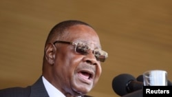 FILE - Former Malawian President Peter Mutharika addresses guests during his inauguration in Blantyre, May 31, 2019. His bodyguard, Norman Chisale, was arrested July 17, 2020, for the second time in a week.