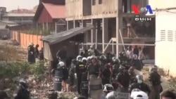 Nine Injured as Housing Demonstrators Clash With Police
