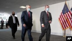 Lider senatske većine Mitch McConnell (lijevo) i republikanski senator Lindsey Graham.