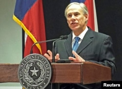 FILE - Texas Attorney General Greg Abbott speaks at a news conference in Austin, Texas, about a lawsuit challenging the president's use of an executive order to ease the threat of deportation for some undocumented immigrants, Dec. 3, 2014.