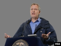 "FILE - New York City Mayor Bill de Blasio: ""We will get through this crisis."""