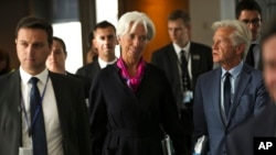 Incoming President of the European Central Bank Christine Lagarde, center, arrives for a meeting of the European Parliament's Economic and Monetary Affairs Committee in Brussels, Wednesday, Sept. 4, 2019. (AP Photo/Francisco Seco)