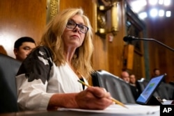 FILE - Sen. Marsha Blackburn, R-Tenn., takes notes during a Senate Judiciary Hearing on Capitol Hill in Washington, July 14, 2021.