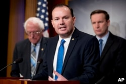 FILE - Sen. Mike Lee, R-Utah, speaks at a news conference on Capitol Hill in Washington, Jan. 30, 2019.